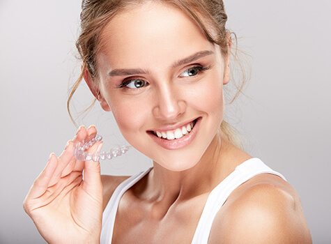 Women with clear aliner invisalign