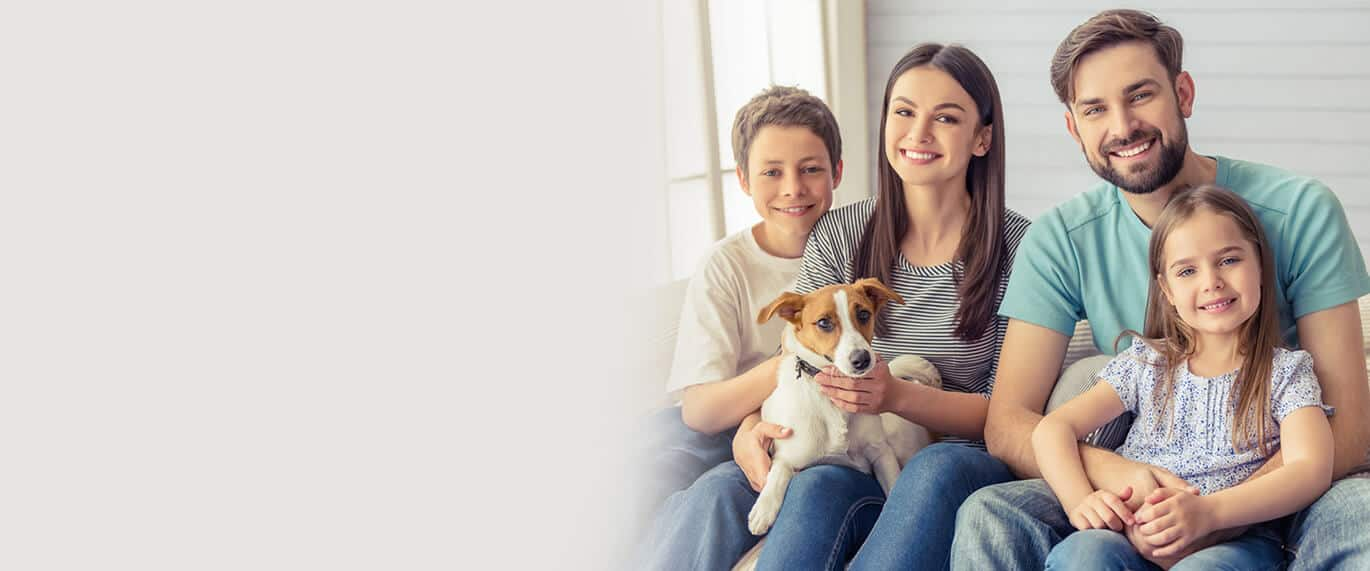 family with their pet dog
