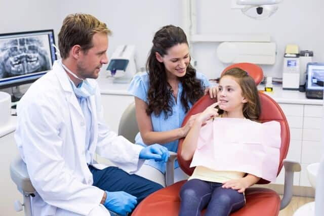 Parents at dental clinic with kids