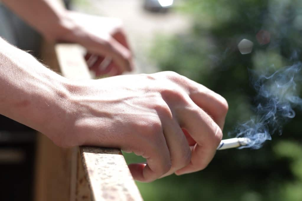 cigarette in hand with smoke